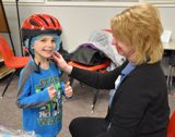 Grant Assists in Providing Students in Need with Bike Helmets for Safety