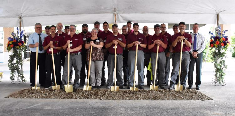 Group photo of Hero Club with shovels for Topping Out Ceremony